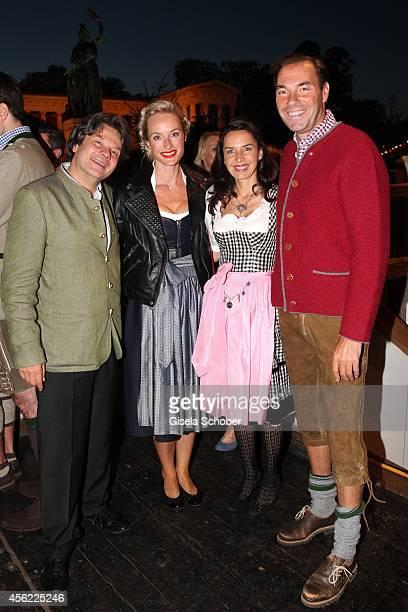 Michael Kaefer Petra Winter Clarissa Kaefer Wolfram Winter during Oktoberfest at Kaeferzelt/Theresienwiese on September 27 2014 in Munich Germany