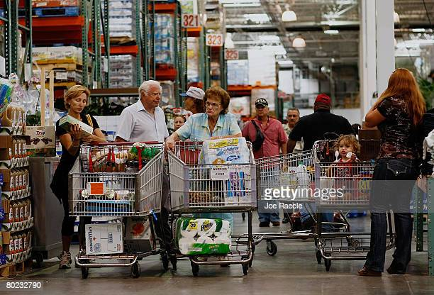 Michael Kaire and Sylvia Kaire and others shop at a Costco store March 13 2008 in North Miami FloridaThe Commerce Department released a report today...