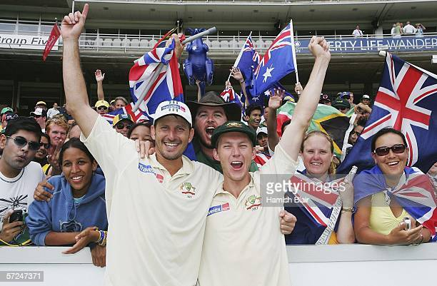 Michael Kasprowicz and Brett Lee of Australia celebrate their 2 wicket win with Australian fans during day five of the Third Test between South...