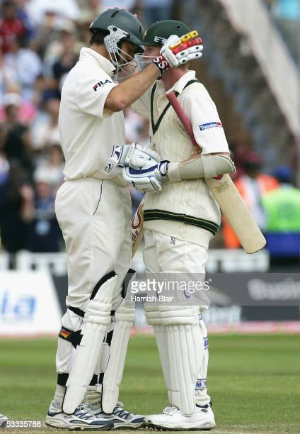 Michael Kasprowicz and Brett Lee of Australia console one another after the final wicket leaving them only two runs short of England during day four...