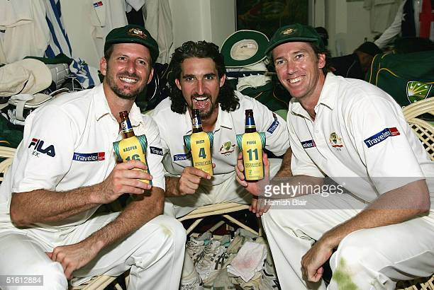 Michael Kasprowicz, Jason Gillespie and Glenn McGrath of Australia celebrate their team's win after day four of the Third Test between India and...