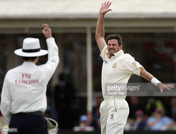 Michael Kasprowicz of Australia appeals successfully for the wicket of Geraint Jones of England as umpire Billy Bowden raises his finger during day...