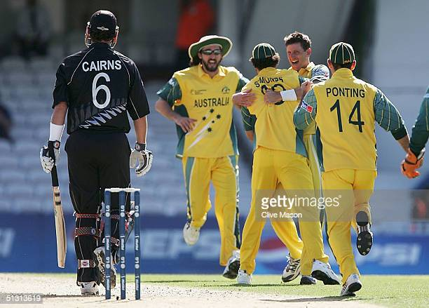Michael Kasprowicz of Australia celebrates with team mates after dismissing Chris Cairns of New Zealand during the ICC Champions Trophy match between...