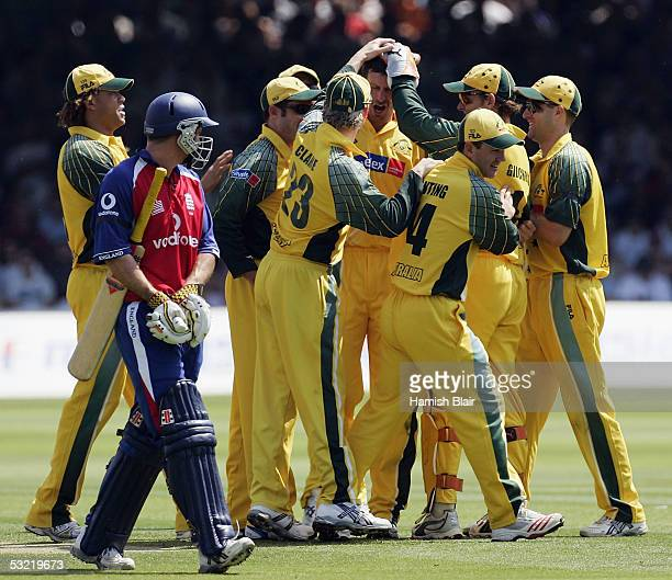 Michael Kasprowicz of Australia is congratulated by team mates on the wicket of Andrew Strauss of England during the NatWest Challenge One Day...