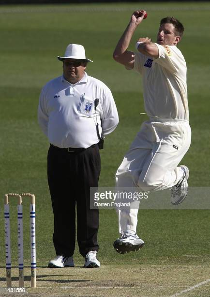 Michael Kasprowicz of Queensland in action against New South Wales during the third days play of the Pura Cup cricket match played between the...