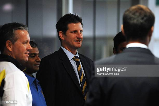 Michael Kasprowicz speaks with players and coaching staff during the ICC U19 Cricket World Cup 2012 opening function at Allan Border Field on August...