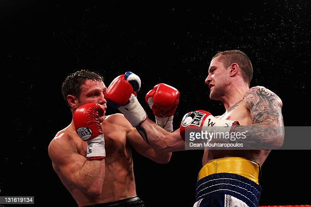 Michael Katsidis of Australia is hit by Ricky Burns of Scotland in their Interim WBO World title fight during Championship Boxing at Wembley Arena on...