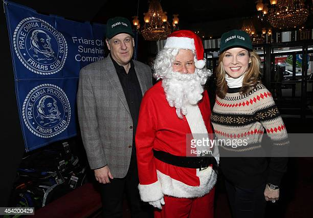 Michael Kay Marvin Scott and Jodi Applegate attend the Cloudy With A Chance of Meatballs 2 Holiday Screening hosted by The Friar's Club at Ziegfeld...
