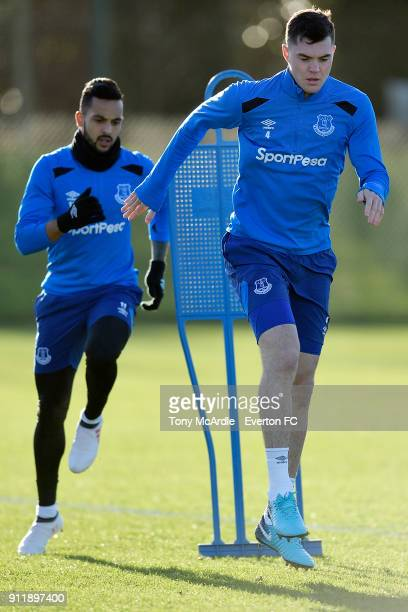 Michael Keane and Theo Walcott during the Everton training session at USM Finch Farm on January 29 2018 in Halewood England