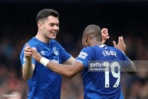Michael Keane celebrates with Djibril Sidibe of Everton after the Premier League match between Everton FC and West Ham United at Goodison Park on...