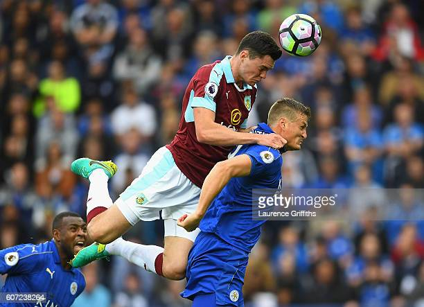 Michael Keane Eof Burnley and Robert Huth of Leicester CiRobert Huth of Leicester City battle for possession in the air during the Premier League...