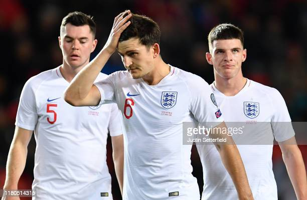 Michael Keane, Harry Maguire and Declan Rice of England look dejected during the UEFA Euro 2020 qualifier between Czech Republic and England at...