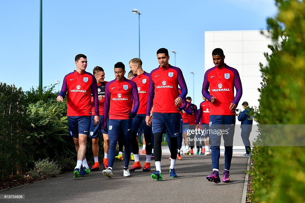 Michael Keane, Jesse Lingard, Chris Smalling and Marcus Rashford walk out for an England training session at the Tottenham Hotspur training ground on October 10, 2016 in Enfield, England.
