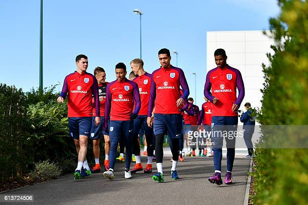 Michael Keane Jesse Lingard Chris Smalling and Marcus Rashford walk out for an England training session at the Tottenham Hotspur training ground on...