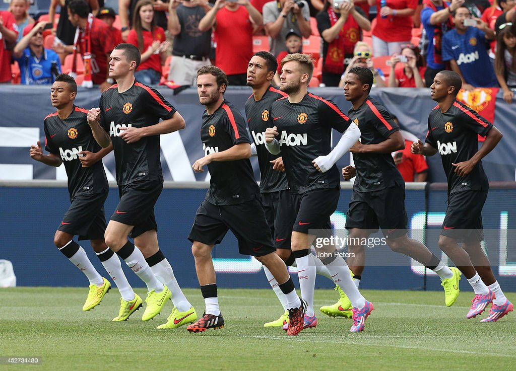 Michael Keane, Juan Mata and Luke Shaw of Manchester United warms up ahead of the pre-season friendly match between Manchester United and AS Roma at Sports Authority Field at Mile High on July 26, 2014 in Denver, Colorado.