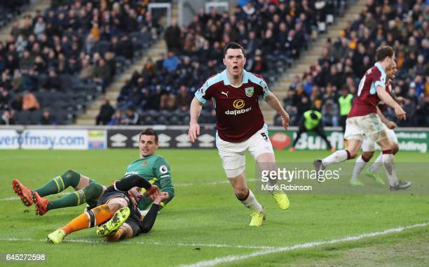 Michael Keane of Burnley celebrates scoring his sides first goal during the Premier League match between Hull City and Burnley at KCOM Stadium on...