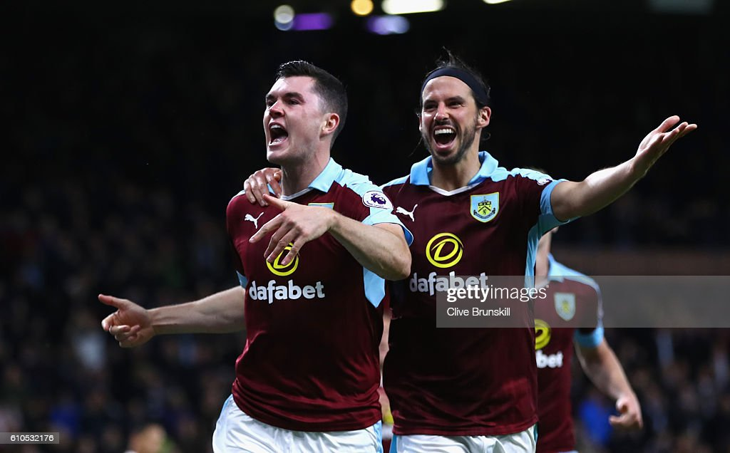 Michael Keane of Burnley (L) celebrates scoring his sides second goal with team George Boyd of Burnley (R) during the Premier League match between Burnley and Watford at Turf Moor on September 26, 2016 in Burnley, England.