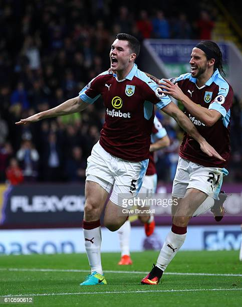 Michael Keane of Burnley celebrates scoring his sides second goal with team mate George Boyd during the Premier League match between Burnley and...