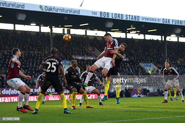 Michael Keane of Burnley heads the ball during the Premier League match between Burnley and Manchester City at Turf Moor on November 26 2016 in...