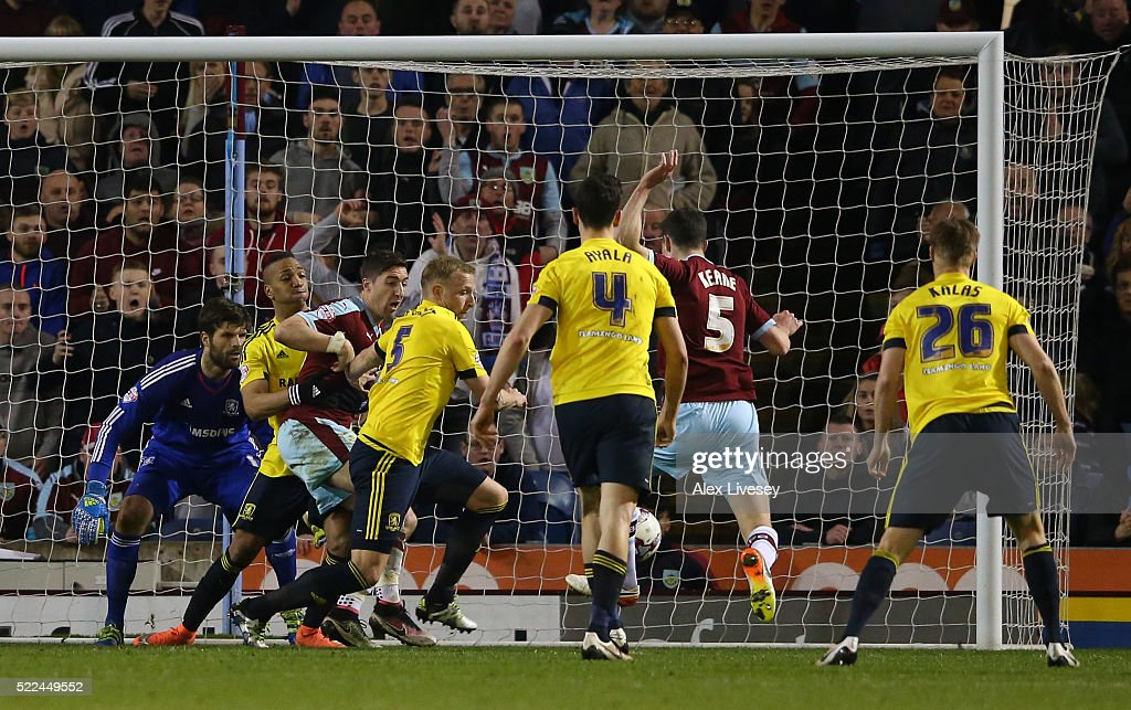 Michael Keane #5 of Burnley scores a late goal to level the scores at 1-1 during the Sky Bet Championship match between Burnley and Middlesbrough at Turf Moor on April 19, 2016 in Burnley, United Kingdom.