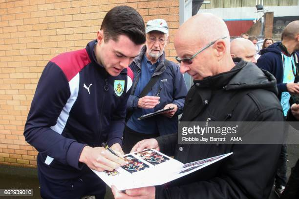 Michael Keane of Burnley signs autographs for fans prior to the Premier League match between Burnley and Tottenham Hotspur at Turf Moor on April 1...