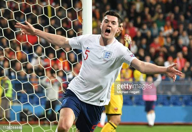 Michael Keane of England celebrates as he scores his team's first goal during the 2020 UEFA European Championships Group A qualifying match between...