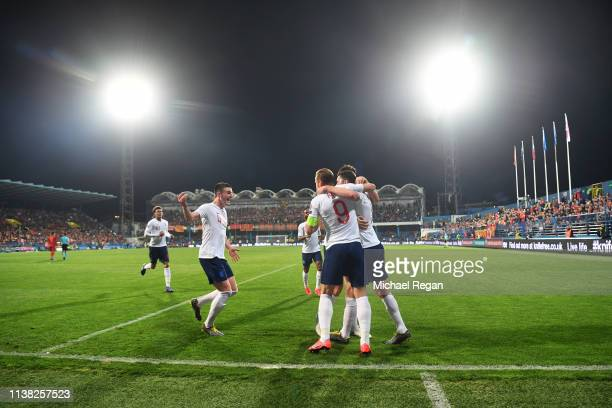 Michael Keane of England celebrates as he scores his team's first goal with team mates during the 2020 UEFA European Championships Group A qualifying...
