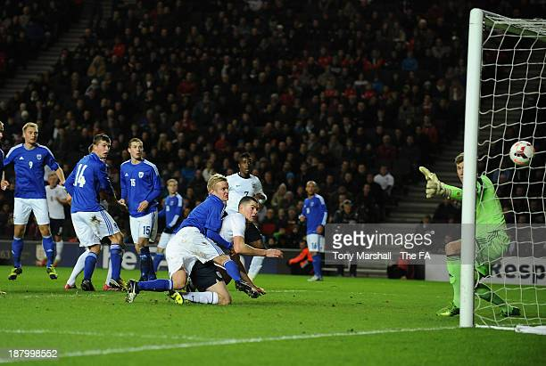Michael Keane of England scoring their first goal during the 2015 UEFA European Under 21 Championship Qualifying match between England U21 and...