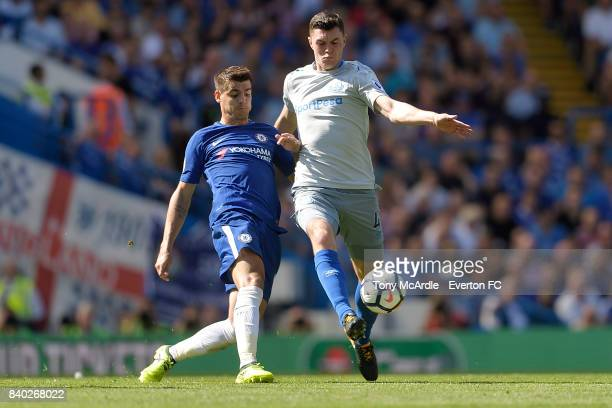 Michael Keane of Everton and Alvaro Morata of Chelsea challenge for the ball during the Premier League match between Chelsea and Everton at Stamford...