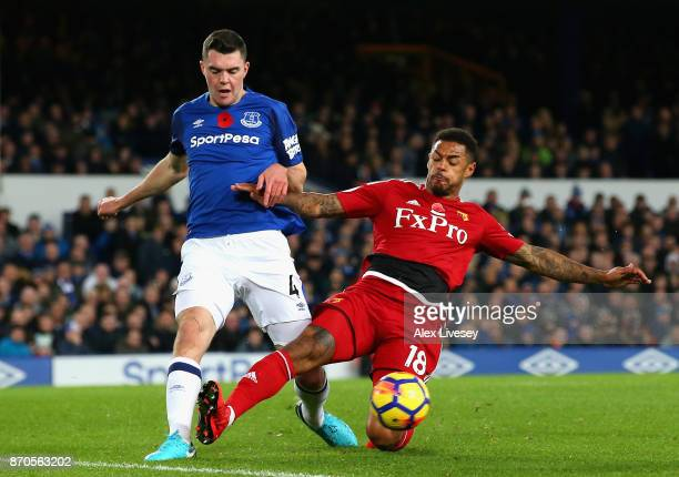 Michael Keane of Everton and Andre Gray of Watford battle for possession during the Premier League match between Everton and Watford at Goodison Park...