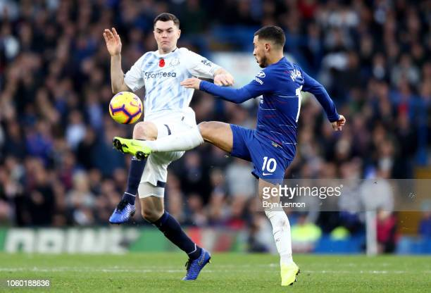 Michael Keane of Everton battles for possession with Eden Hazard of Chelsea during the Premier League match between Chelsea FC and Everton FC at...
