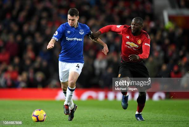 Michael Keane of Everton battles for possession with Romelu Lukaku of Manchester United during the Premier League match between Manchester United and...