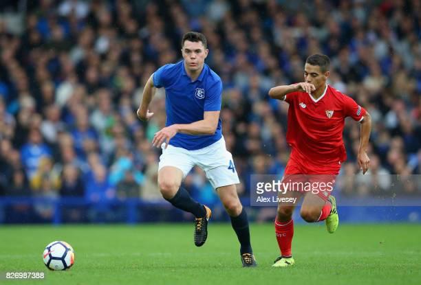 Michael Keane of Everton beats Wissam Ben Yedder of Sevilla during a preseason friendly match between Everton and Sevilla at Goodison Park on August...