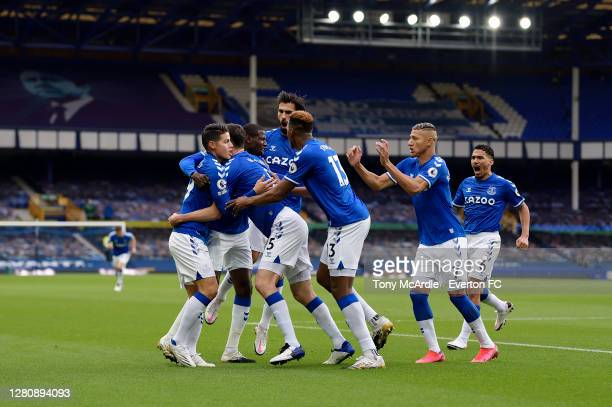 Michael Keane of Everton celebrates his goal with James Rodriguez Abdoulaye Doucoure Andre Gomes Yerry Mina Richarlison and Allan during the Premier...