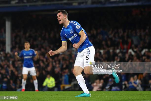 Michael Keane of Everton celebrates scoring his teams first goal during the Premier League match between Everton and Burnley at Goodison Park on...