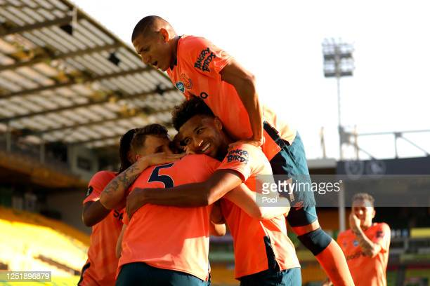 Michael Keane of Everton celebrates with his team mates after scoring his team's first goal during the Premier League match between Norwich City and...