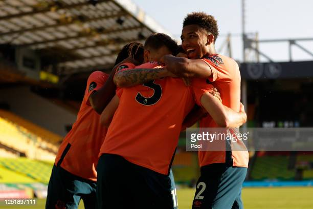 Michael Keane of Everton celebrates with Mason Holgate Lucas Digne and Alex Iwobi after scoring his team's first goal during the Premier League match...