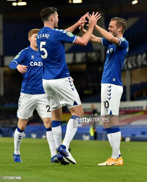 Michael Keane of Everton celebrates with teammate Gylfi Sigurdsson after scoring his team's first goal during the Carabao Cup Second Round match...