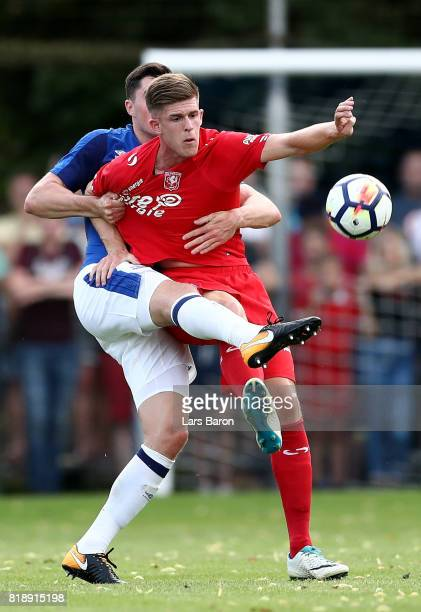 Michael Keane of Everton challenges Marko Kvasina of Twente during a preseason friendly match between FC Twente and Everton FC at Sportpark de...