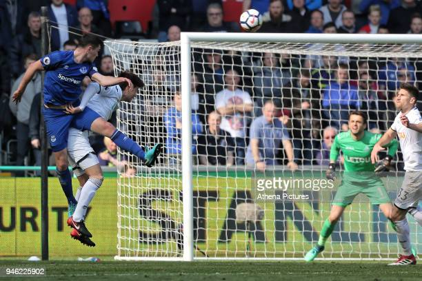 Michael Keane of Everton heads the ball over Ki SungYueng of Swansea City during the Premier League match between Swansea City and Everton at The...