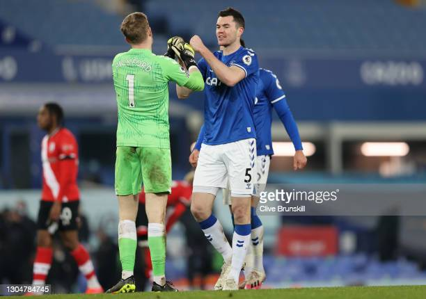 Michael Keane of Everton interacts with Jordan Pickford after the Premier League match between Everton and Southampton at Goodison Park on March 01,...
