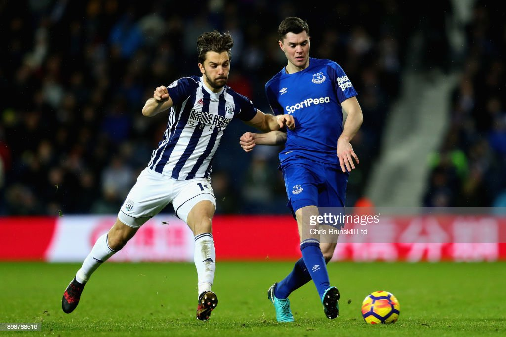 Michael Keane of Everton is challenged by Jay Rodriguez of West Bromwich Albion during the Premier League match between West Bromwich Albion and Everton at The Hawthorns on December 26, 2017 in West Bromwich, England.