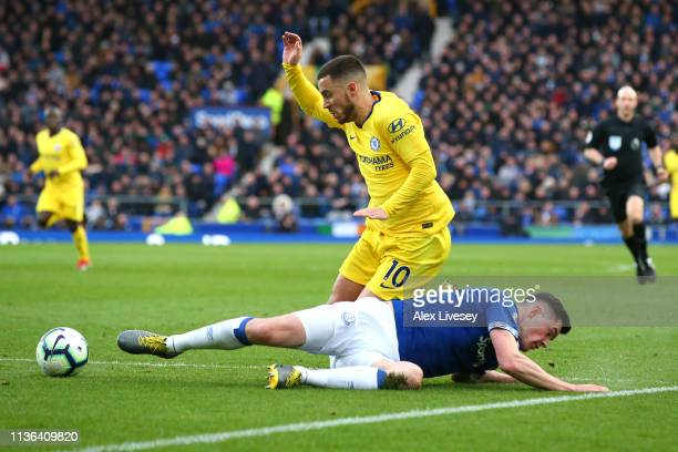 Michael Keane of Everton is tackled by Eden Hazard of Chelsea during the Premier League match between Everton FC and Chelsea FC at Goodison Park on...