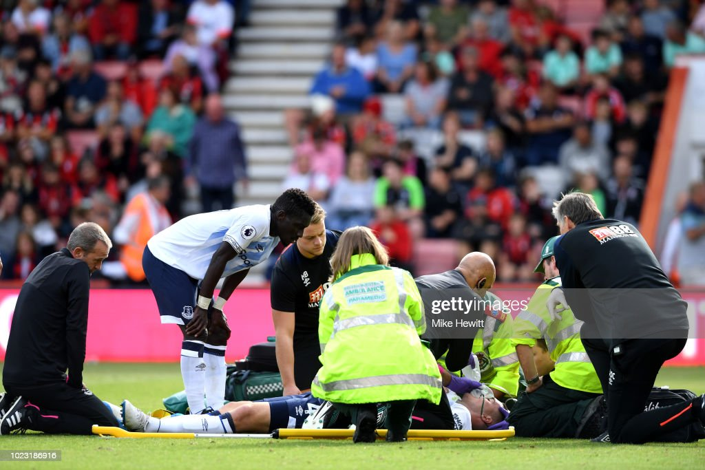 Michael Keane of Everton receives medical treatment during the Premier League match between AFC Bournemouth and Everton FC at Vitality Stadium on August 25, 2018 in Bournemouth, United Kingdom.