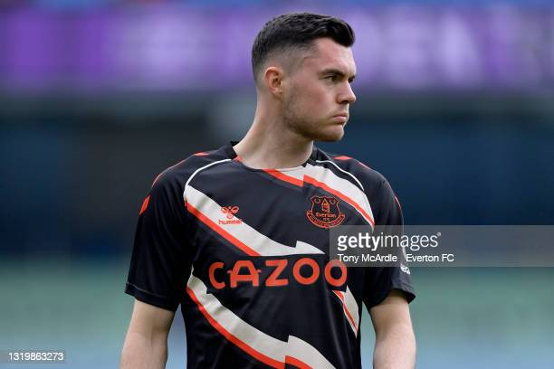 Michael Keane of Everton warms up before the Premier League match between Manchester City and Everton at the Etihad Stadium on May 23, 2021 in...