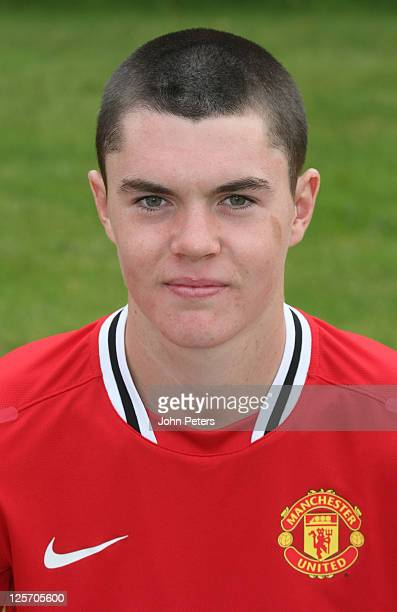 Michael Keane of the Manchester United Reserve Team squad poses at the annual club photocall at Carrington Training Ground on September 16 2011 in...