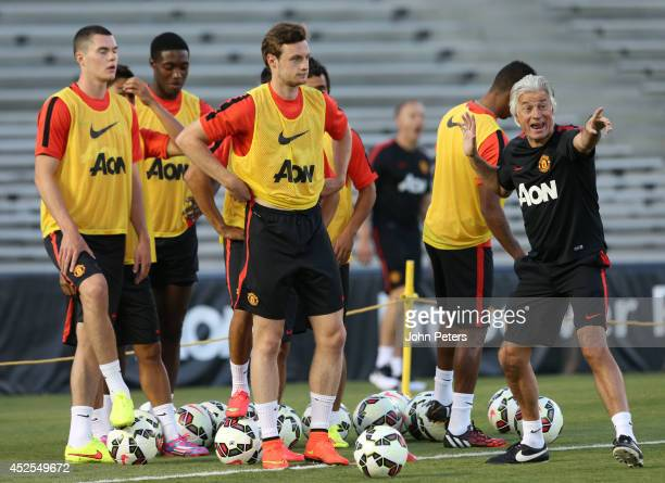 Michael Keane, Will Keane and Opposition scout Marcel Bout of Manchester United in action during an open training session as part of their pre-season...