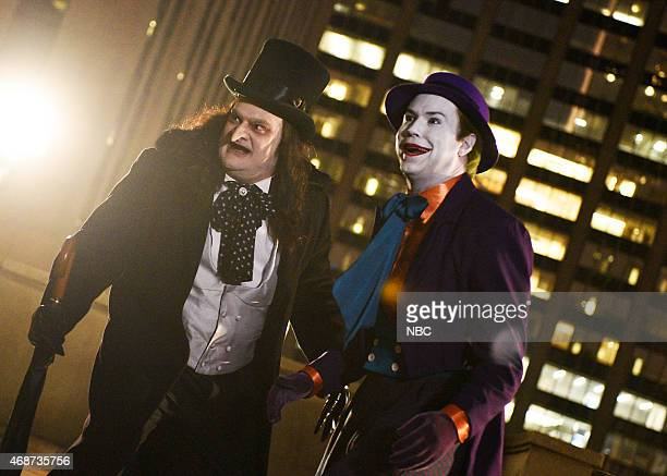 LIVE Michael Keaton Episode 1679 Pictured Bobby Moynihan as The Penguin and Taran Killam as The Joker during the monologue on April 4 2015