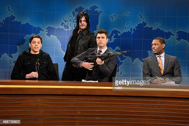 LIVE Michael Keaton Episode 1679 Pictured Pete Davidson Norman Reedus Colin Jost and Michael Che during Weekend Update on April 4 2015
