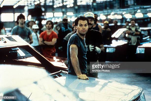 Michael Keaton hangs out at a dealership in a scene from the film 'Gung Ho' 1986